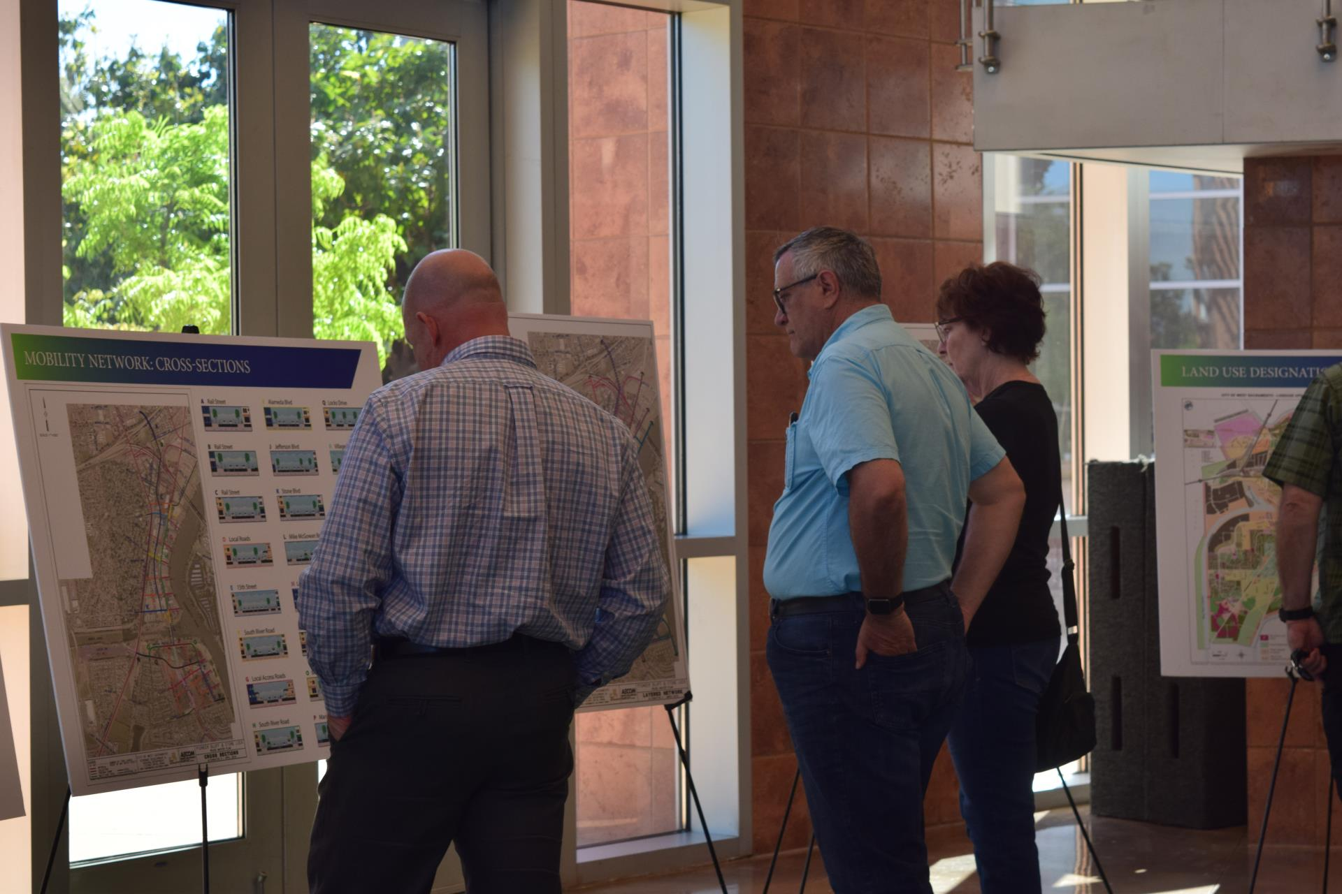 pioneer bluff open house residents read poster boards