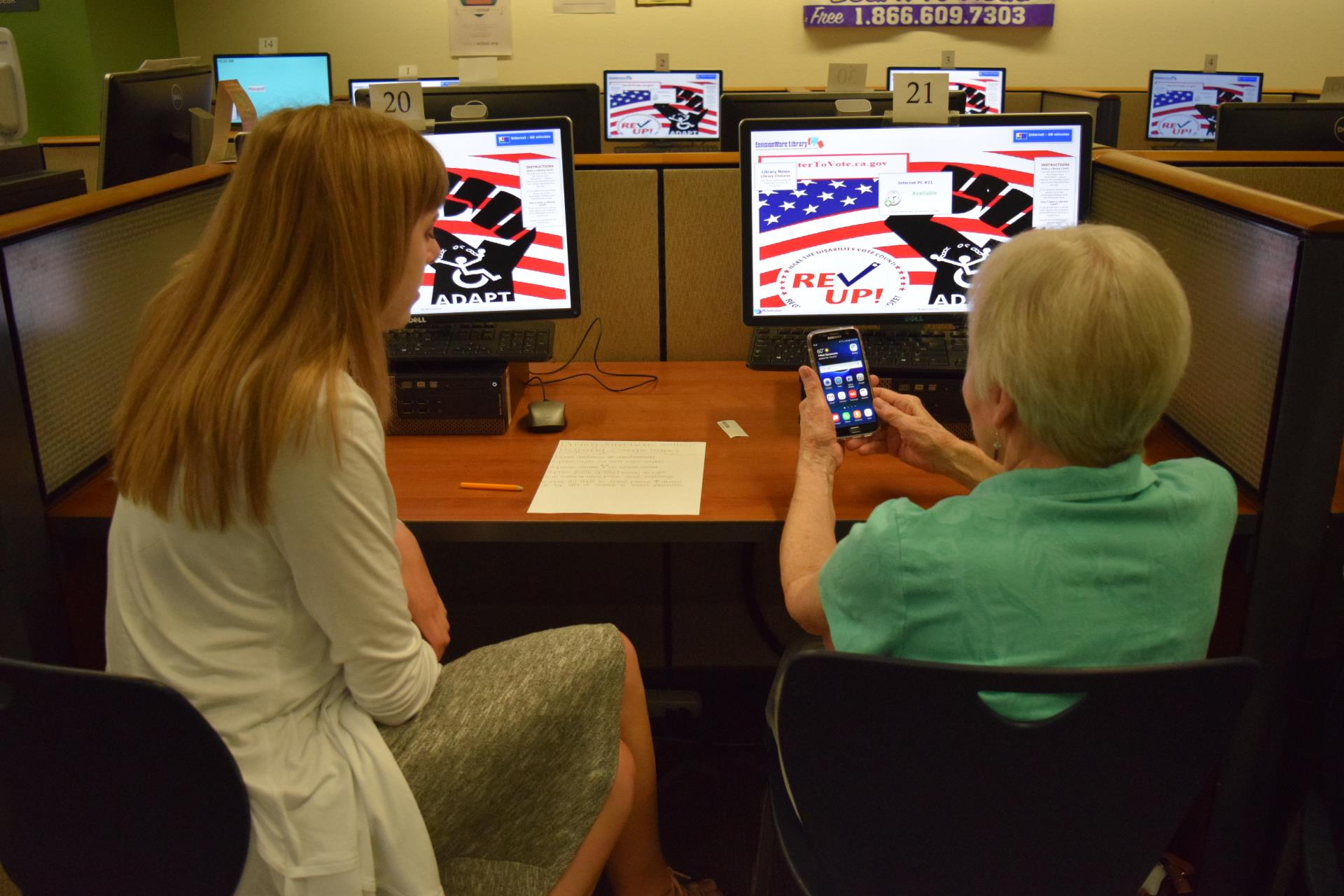 generation tech camp volunteer helps train senior on use of cellphone