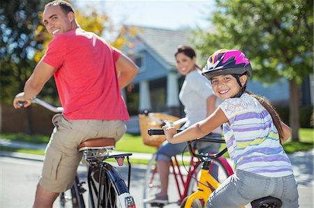 stock latino family on bikes