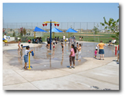 Families enjoying the spraygrounds