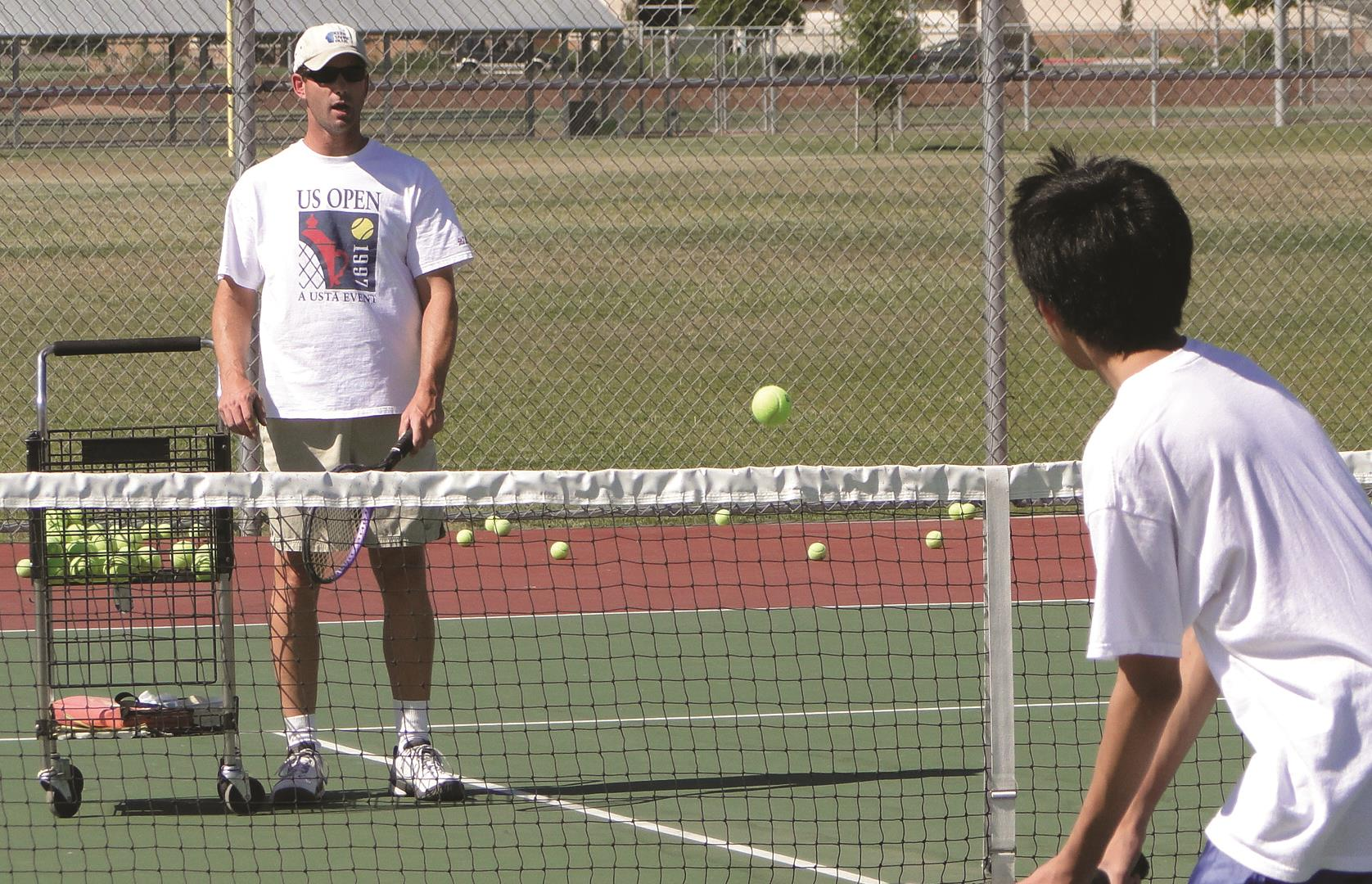Recreation Center Tennis Coach teaching lesson