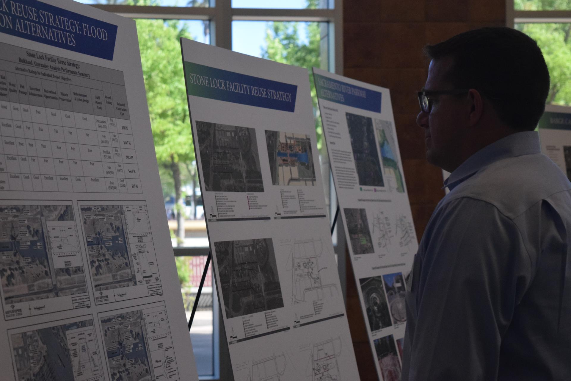 pioneer bluff open house resident reads display boards