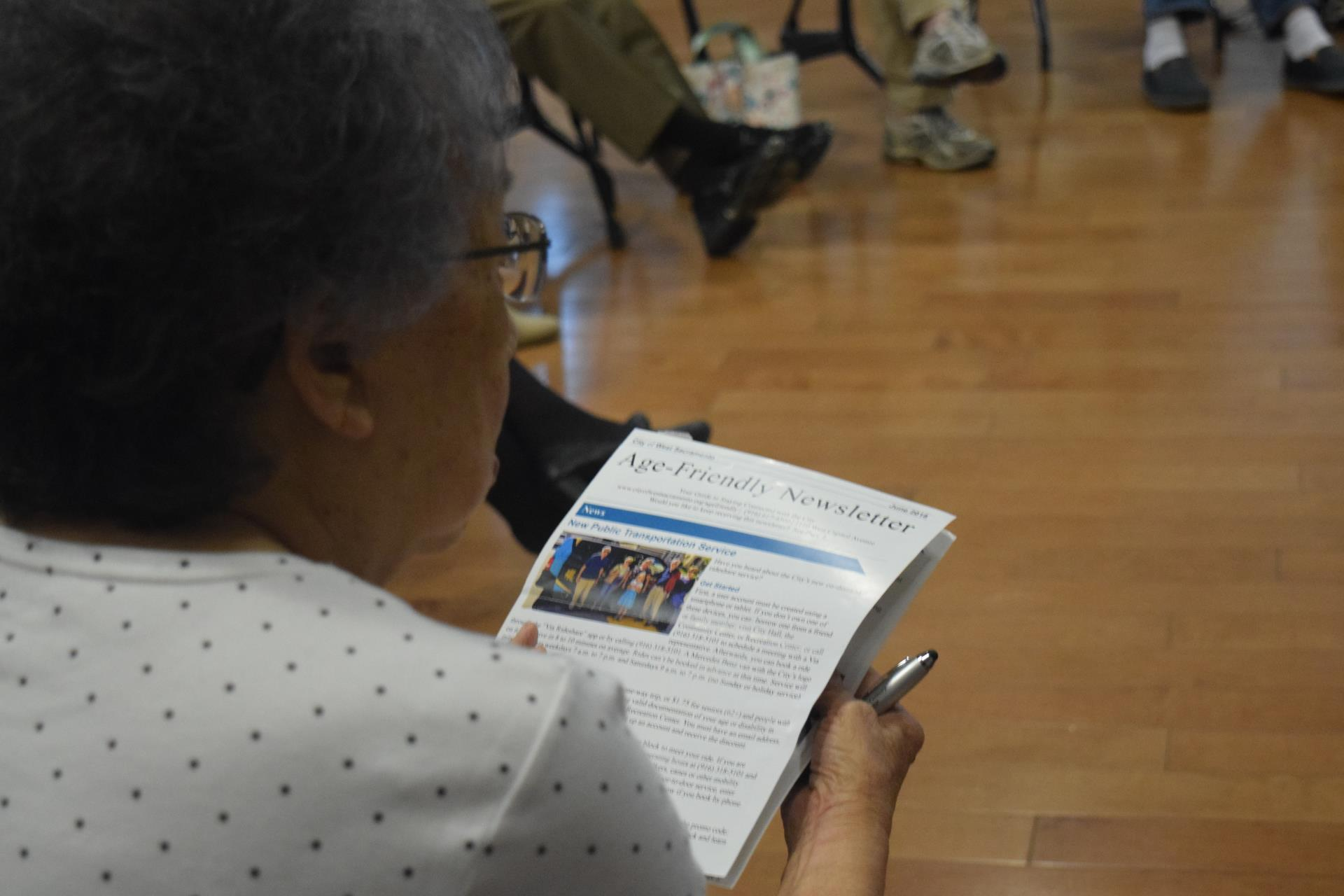 senior reading age-friendly newsletter