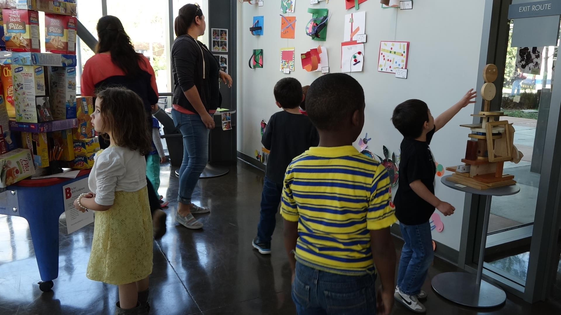 crowd gathers at learning ladder art show 2016