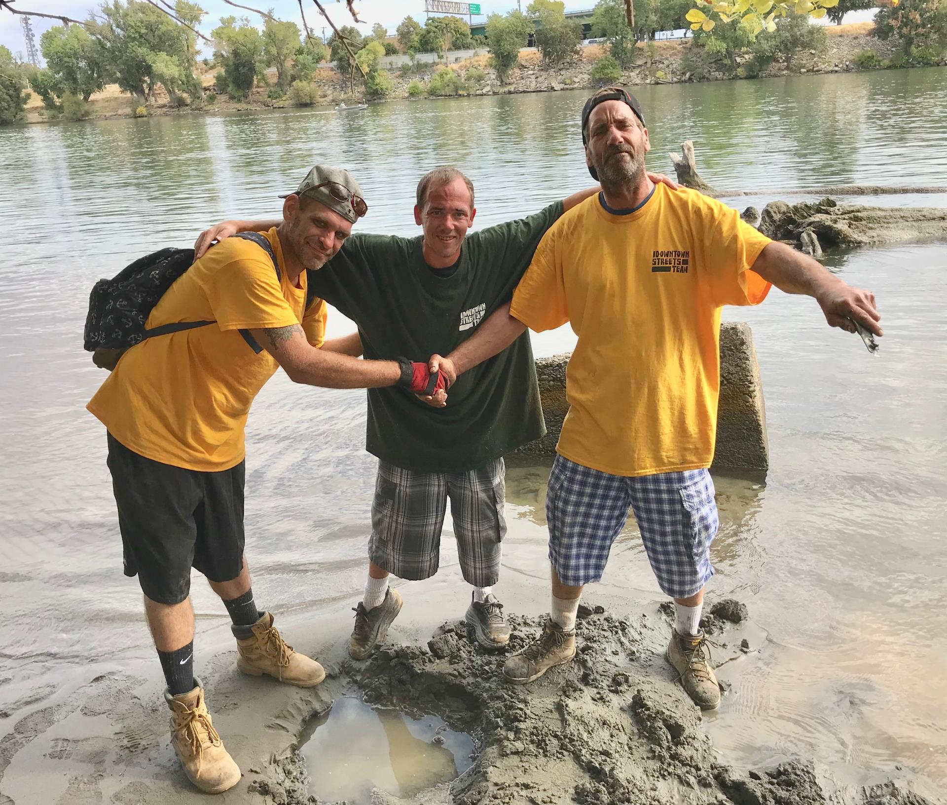 downtown streets team participants help clean river