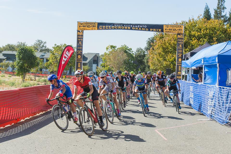 racers cross the finish line at cyclocross grand prix west sac