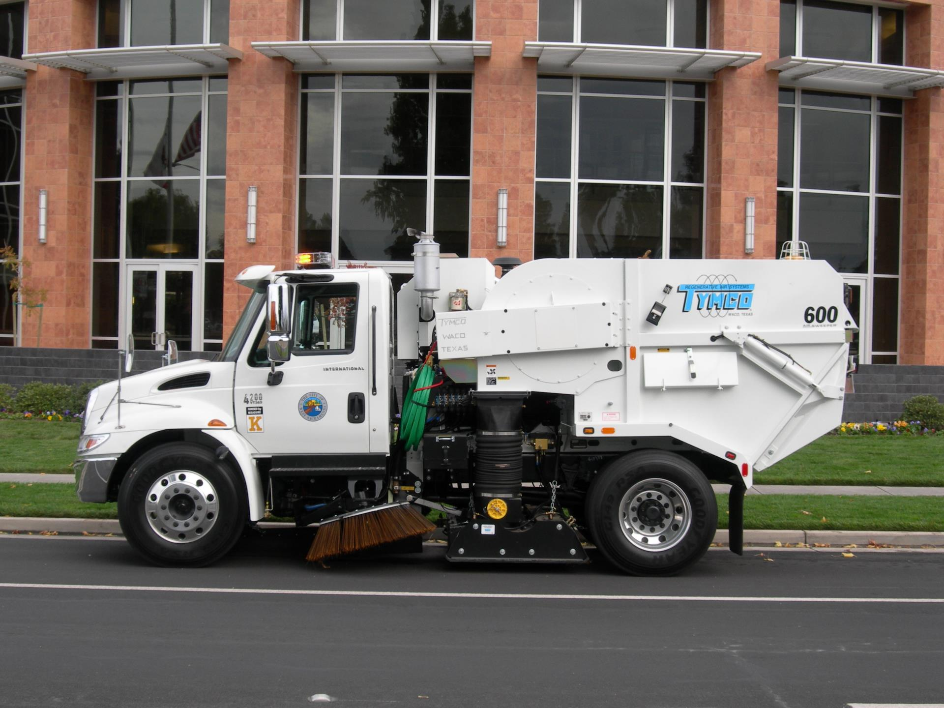photo of street sweeper in front of city hall