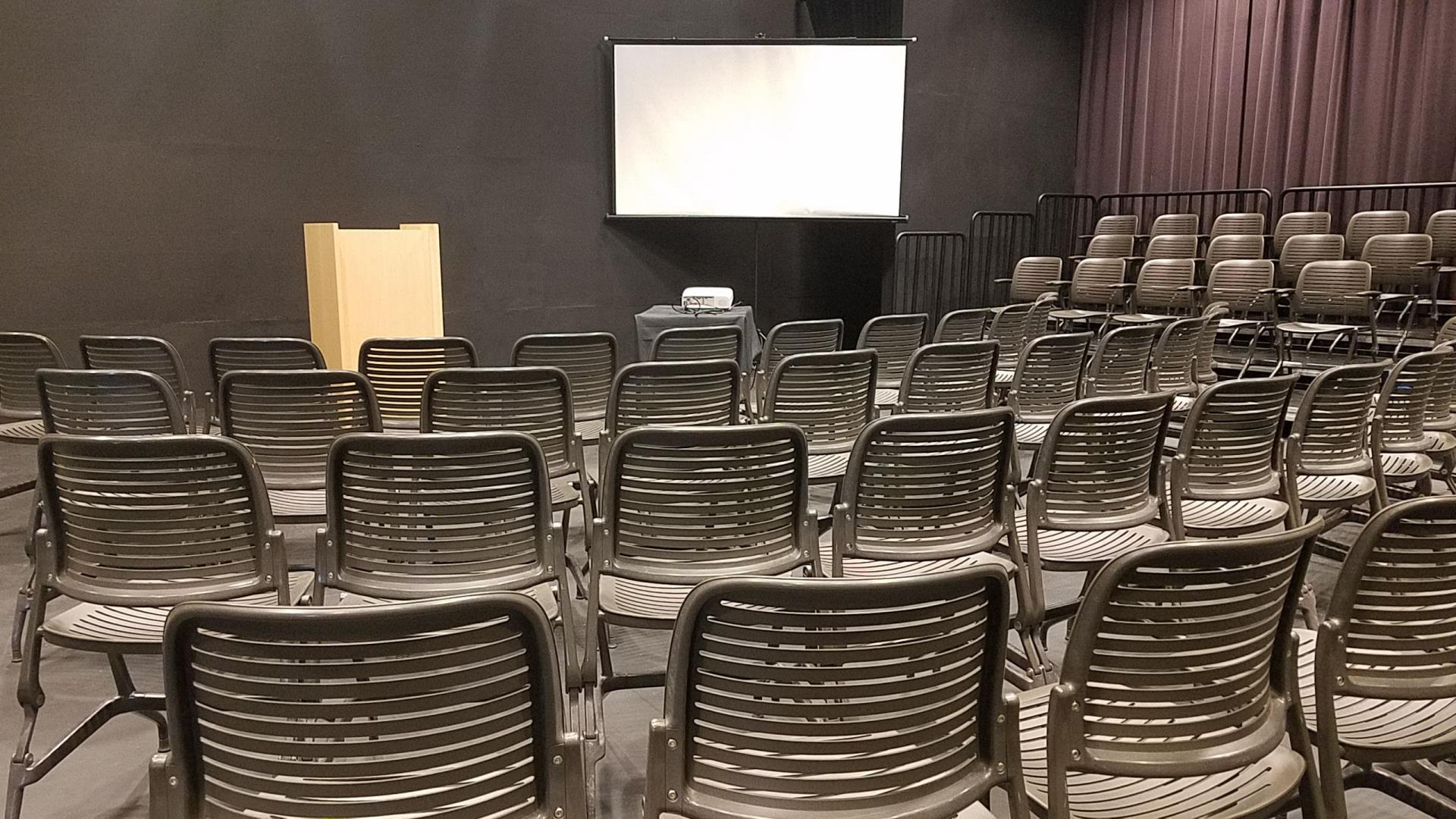 Lecture setup with small screen in theater