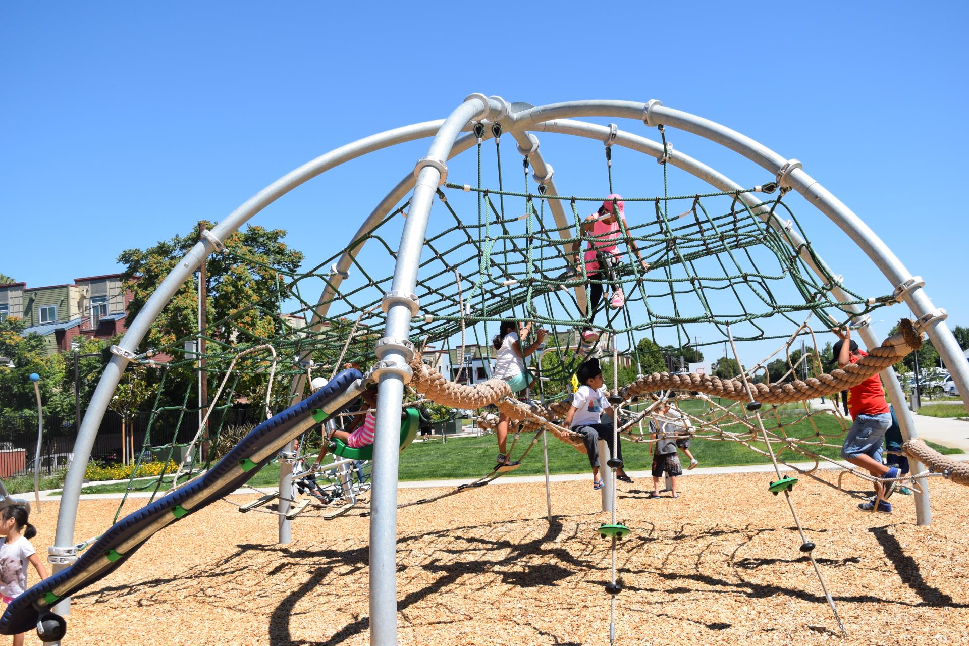 Children playing closely on a jungle gym