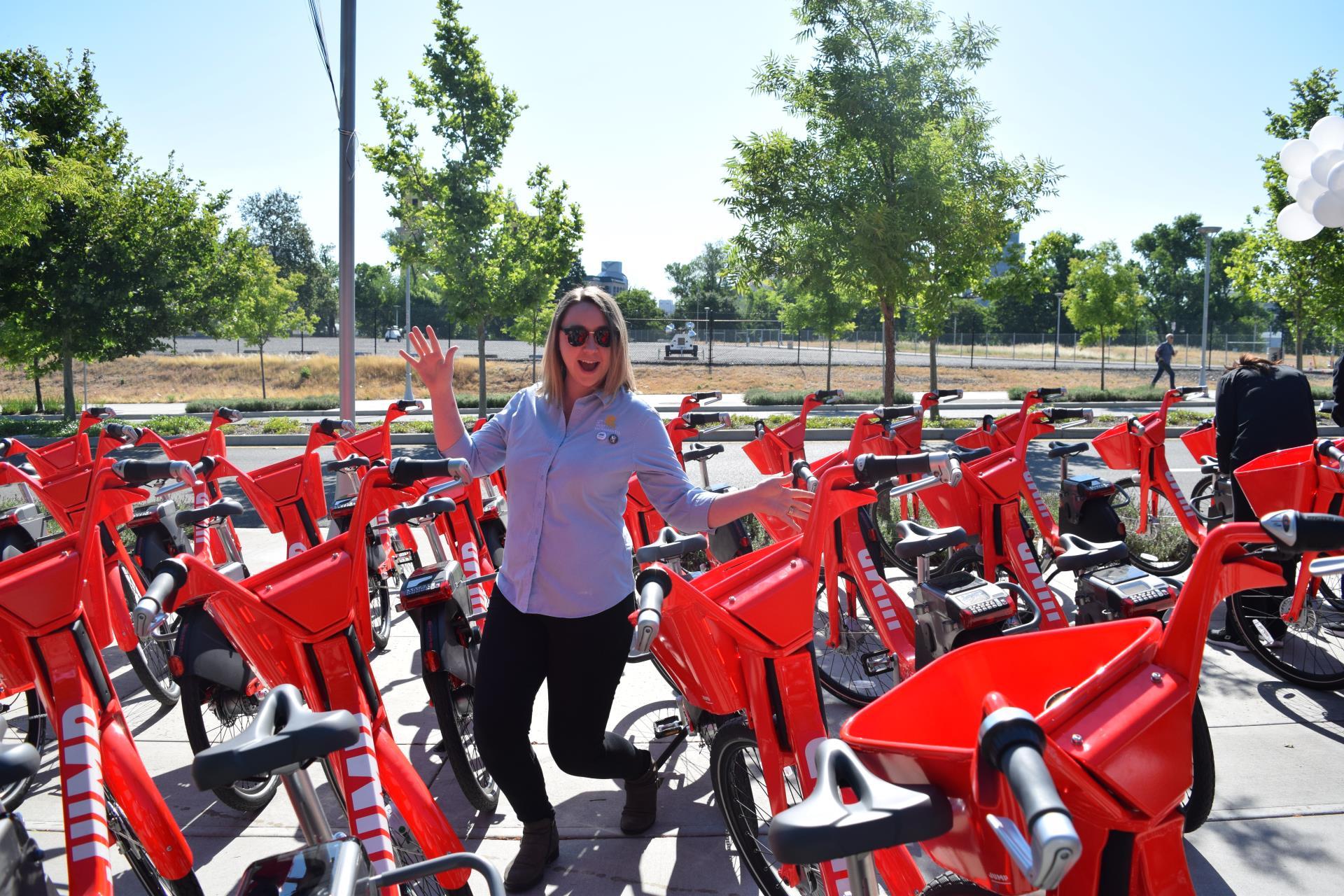 jump bikes photo with city staff member sarah strand at raley field