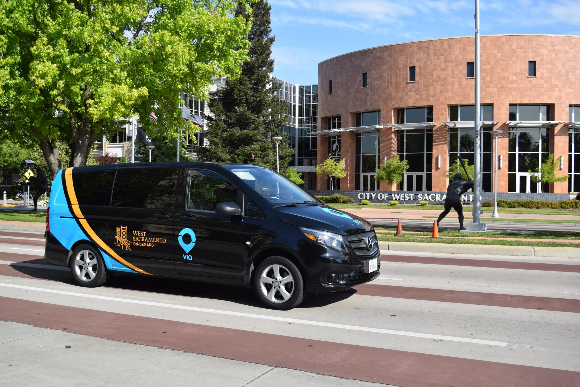 via van drives by city hall